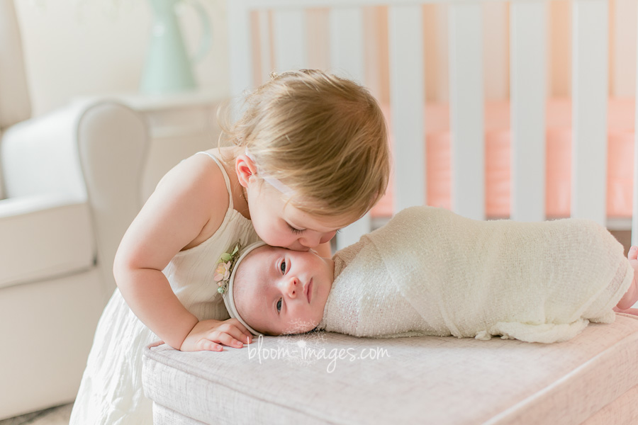 Baby sisters kissing, Newborn photographer in Northern VA